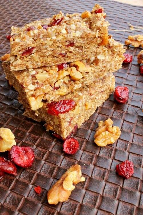 No-Bake Orange Cranberry Snack Bars - Great for on-the-go snacking to give your kids energy. They'll enjoy helping to make them too! Found at The Happy Housewife