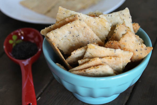A few modifications to my paleo pie crust recipe resulted in these perfectly cheesy, grain-free poppy seed cheese crackers! Found at The Happy Housewife