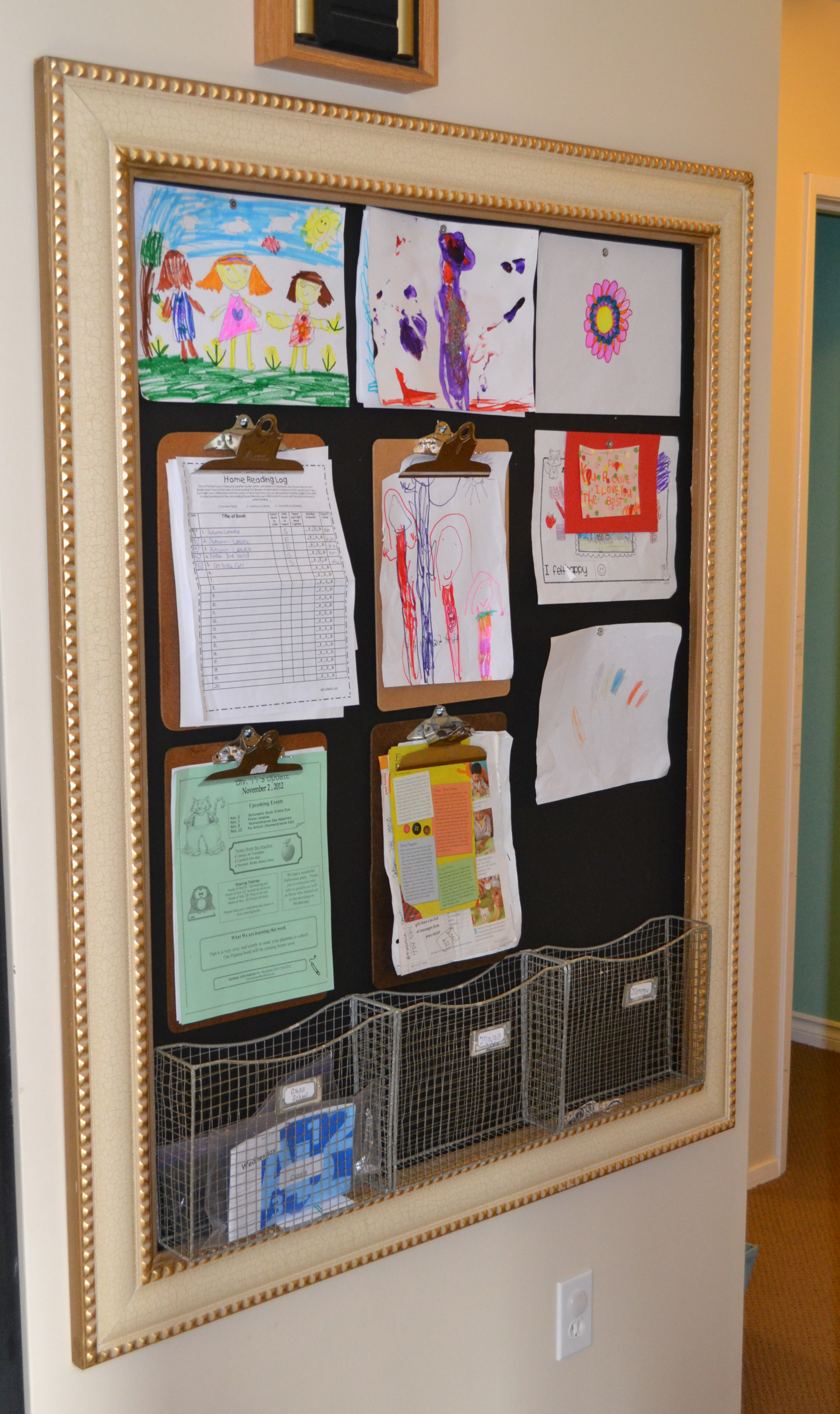 Organizing kids artwork and schoolwork the happy for Picture frames organized on walls