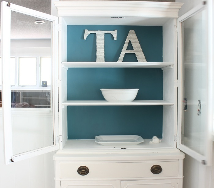 White cabinet with Annie Sloan pure white chalk paint. Interior is a mixture of Aubussen Blue and Florence.