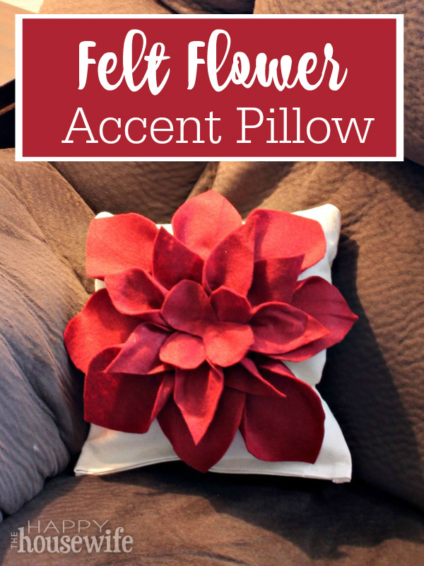 This felt flower accent pillow is easy to make in just about an hour. There are only a few supplies to gather and no sewing required. 100 Days of Homemade Christmas Gifts at The Happy Housewife