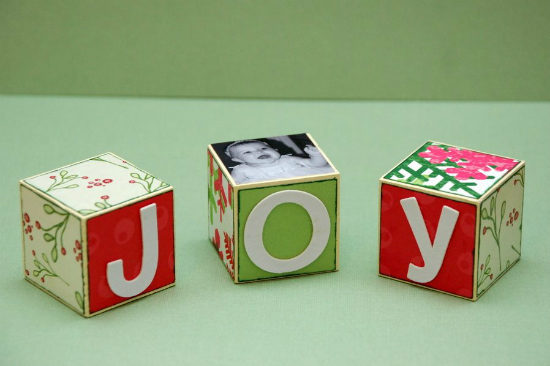Use letters, decorative paper, and/or photos to decorate these wooden blocks with a holiday message. 100 Days of Homemade Christmas Gifts at The Happy Housewife
