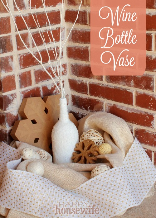 This snowy wine bottle vase craft is an easy and inexpensive way to add a beautiful touch of winter to any mantle, centerpiece, or just about any place you need a vase.