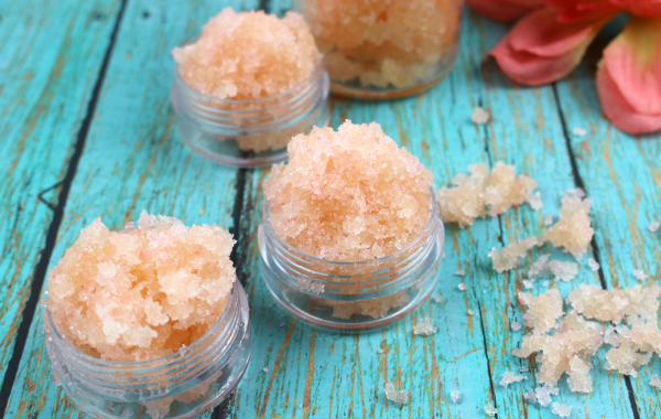 This Tangerine Lip Scrub exfoliates dry skin around your lips and helps to moisturize them. It's easy to make and has a delicious tangerine flavor.
