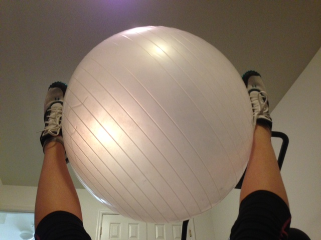 ab isolation leg lift with yoga ball