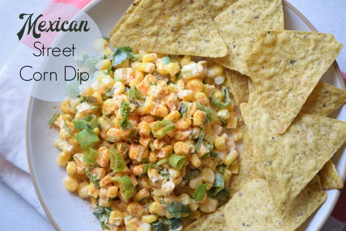 This Mexican Street Corn Dip is a delicious appetizer that is served with tortilla chips.