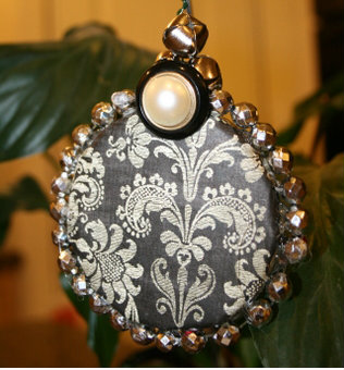 Black damask ornament for pennies