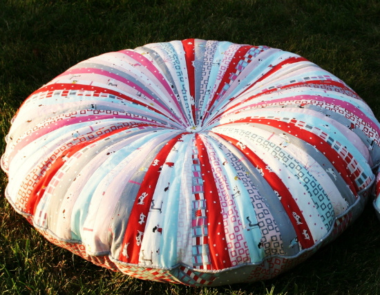with your sewing machine and jelly roll fabric you can make this adorable floor pillow for